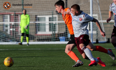 Chris Mochrie fighting the midfield battle for United
