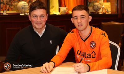 fin malcolm and andy goldie as he signs his papers