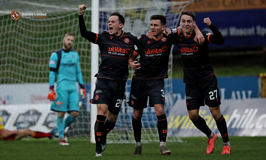 Celebrations after Spörle's goal at the Energy Check Stadium